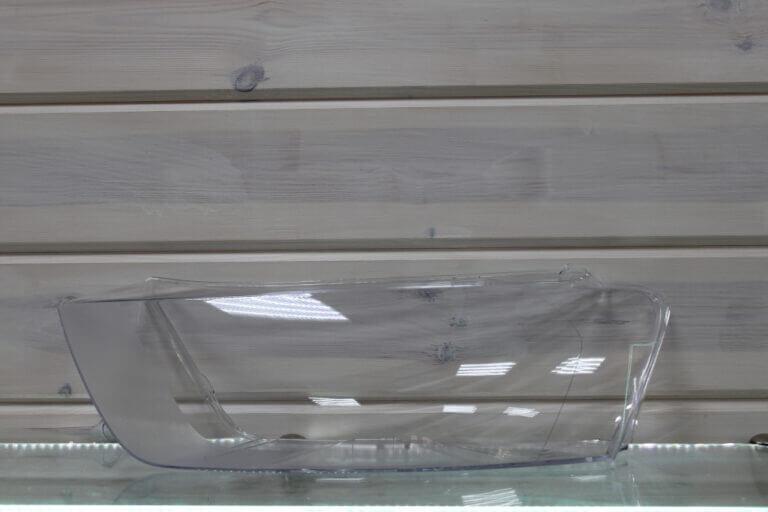 Стекло на левую фару для Audi Q3 2011-2015 дорестайлинг