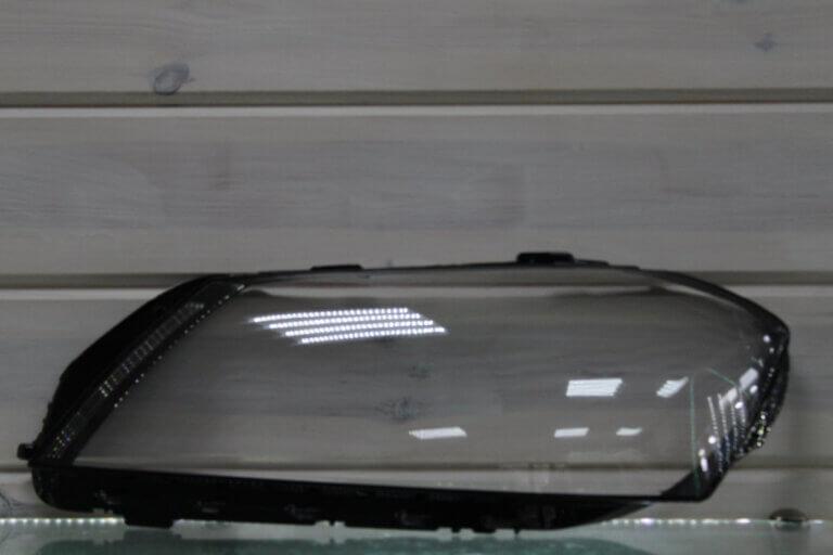 Стекло на левую фару для Volkswagen Passat B7 2010-2015